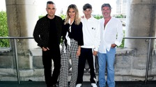 Louis Tomlinson (second right) with his fellow X Factor judges.
