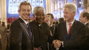 Nelson Mandela with the Bill Clinton and Tony Blair at Westminster London in 2003.
