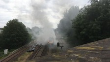 Passengers were evacuated from the train after it caught fire near Derby.