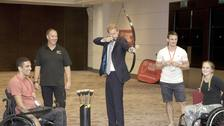 The Duke of Sussex tries archery during a visit to the RFU Injured Players Foundation's annual Client Forum at Twickenham Stadium.