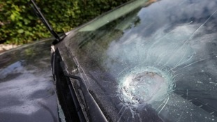 Damage was caused to a car during an attack on the home of former Sinn Féin president Gerry Adams