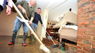Floodwater is cleared from a house in in Croston, Lancashire, after the river Yarrow burst its banks.