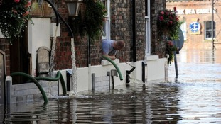 A man watches flood water rise in York as the River Ouse rises after flood in September 2012