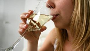 women drinks wine