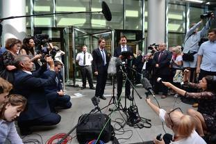 Sir Cliff Richard (centre) with his lawyer, Gideon Benaim, outside the Rolls Building in London