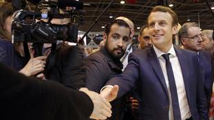 Then presidential candidate Emmanuel Macron, flanked by his bodyguard, Alexandre Benalla.