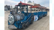 The train is described as a 'blue locomotive with a Thomas the Tank Engine face'.