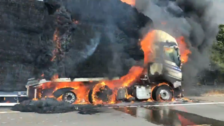 Footage shows flames engulf lorry carrying hay bales