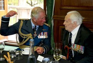 The Prince of Wales talks to Battle of Britain veteran Squadron Leader Geoffrey Wellum