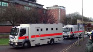 Police vans thought to be carrying at least one of the defendants in the Dale Cregan trial arrive at Preston Crown Court.