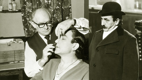 Stuart Freeborn applying a false nose to Albert Finney to transform him into Agatha Christie's Poirot