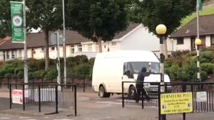 The video shared on social media caught a rioter throwing a petrol bomb at a moving van in Derry