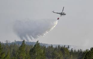 A helicopter tackles the fires