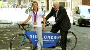 Boris Johnson and Laura Trott announcing the initiative during last summer's Olympics