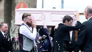 Pink coffin carried as mourners bid farewell to killed six-year-old