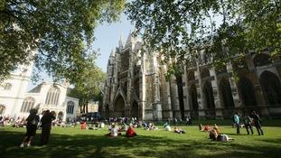 People enjoying the warm weather outside Westminster Abbey last year.