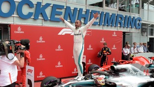 Lewis Hamilton wins the German Grand Prix after Sebastian Vettel crashes out in the wet