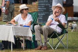 A man applies sun cream during the Thames Traditional Boat Festival