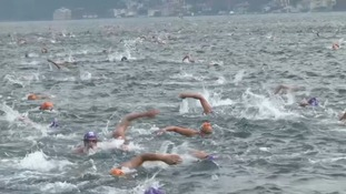 Istanbul's Bosphorus Strait race sees swimmers battle all the way from Asia to Europe