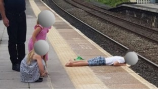 Investigation launched after child seen lying with head over train platform edge