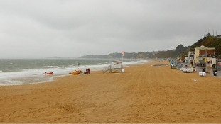 An almost deserted Bournemouth beach on a wet Bank Holiday Monday.