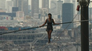Daredevil tightrope walker watches her step 35-metres above Paris
