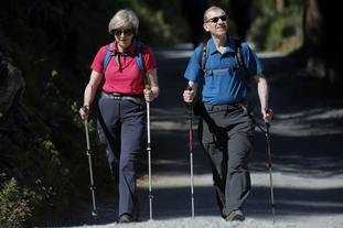 Theresa May has given details of how she likes to unwind, including walking holidays with husband Philip (Marco Bertorello/PA)