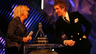 Bradley Wiggins chats to Sue Barker on stage during the Sports Personality of the Year Awards 2012,