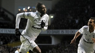 Tottenham Hotspur's Emmanuel Adebayor (left) celebrates with team-mate Kyle Naughton after scoring his side's second goal of the game