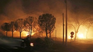 Buildings burn in the town of Mati, east of Athens.