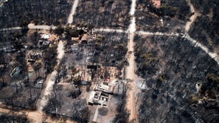 Aerial photo shows burnt houses and trees following a wildfire in Mati, east of Athens.