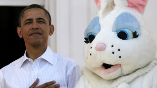 President Barack Obama stands next to the Easter Bunny during the singing of the National Anthem, at the White House in Washington