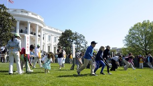 Children participate in the annual White House Easter Egg Roll on the South Lawn of the White House in Washington.
