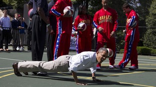 President Barack Obama does pushups during the White House Easter Egg Roll hosted by the president and first lady Michelle Obama.