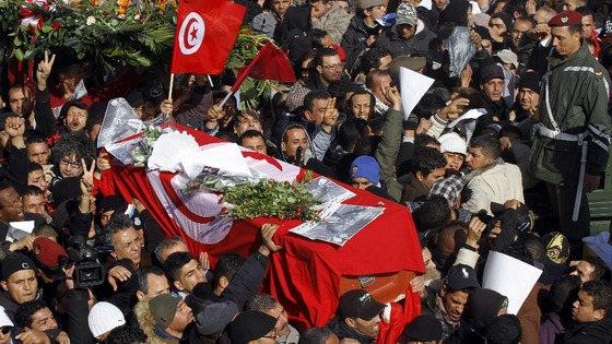 Mourners carry the coffin of slain opposition leader Chokri Belaid