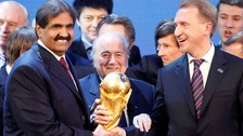 Former FIFA President Joseph Blatter with Sheikh Hamad bin Khalifa Al-Thani, Emir of Qatar, after Qatar became tournament host for 2022.