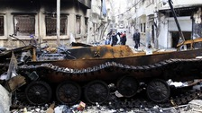 A damaged armoured vehicle belonging to the Syrian army