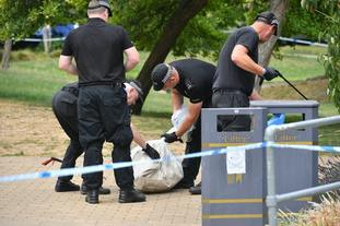 Police searching a park in Salisbury for evidence