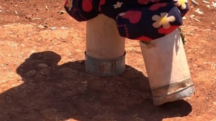 Maya's father made her makeshift legs to help her get around one of Syria's camps for the displaced.