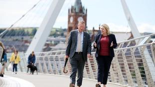 NI Secretary of State Karen Bradley walks across the Peace Bridge during a visit to Derry