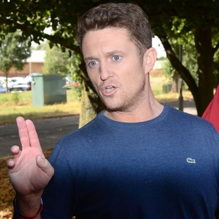 Tommy Robinson refused to answer questions from journalists as he was flanked by supporters upon his release from prison.