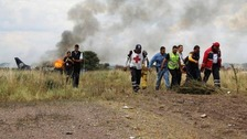 The scene in Durango following the flight that crashed into a field near the runway in Mexico.