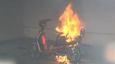 Seconds after their escape, the scooter exploded with flames engulfing the room.