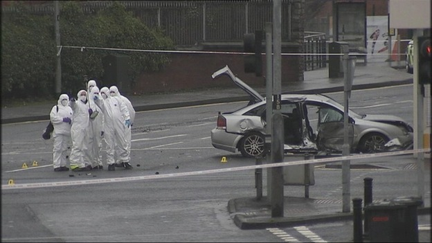 Forensic experts at the scene of the collision in Londonderry, Northern Ireland