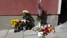 Flowers left at the scene where a Eric Torell, 20, was shot and killed by police in Stockholm.