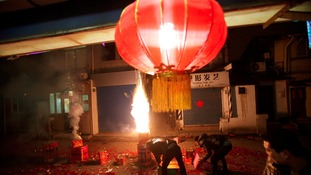 Men set off fireworks as residents celebrate the start of the Chinese New Year in Shanghai
