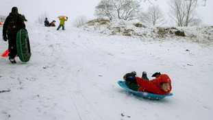 DATE IMPORTED:February 8, 2013A boy sleds down a hill at a golf course during a snow storm in Pelham Manor, New York