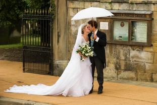 Lady Melissa Percy kisses Thomas van Straubenzee on their wedding day