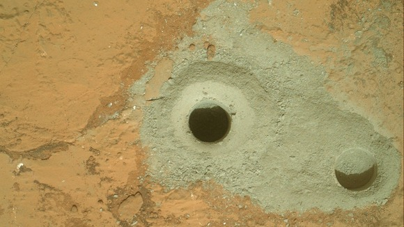 the hole in a rock called &quot;John Klein&quot; where the rover conducted its first sample drilling on Mars
