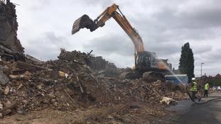 Demolition underway of derelict building destroyed in huge fire